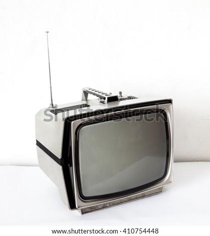 Vintage Gray TV on white table - stock photo