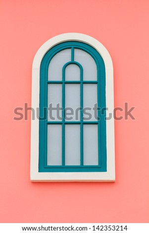 Vintage green and white window on pink wall