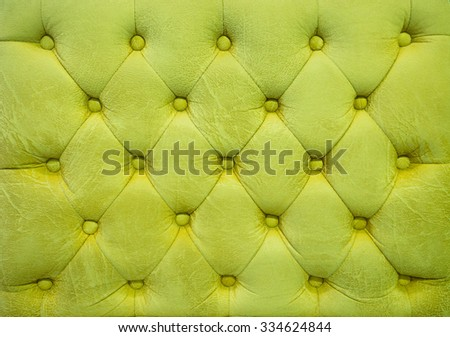 Vintage green grass leather upholstery buttoned sofa (background) - stock photo