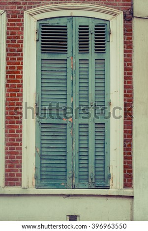 Vintage grey blue window with shutters. Closed sealed.
