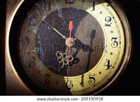 Vintage grunge clock face with vintage roman numerals - stock photo