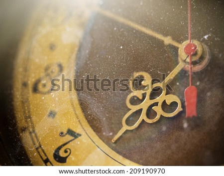 Vintage grunge clock face with vintage roman numerals, tinted photo - stock photo