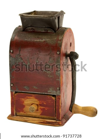 Vintage grunge manual coffee grinder on white