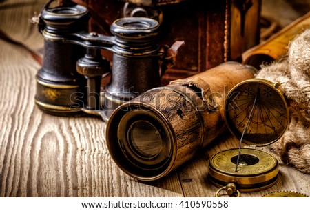 Vintage grunge still life. Antique items on wooden table. Travel geography navigation concept background. - stock photo