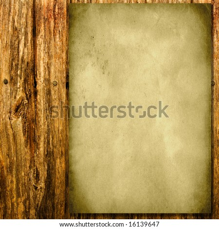 vintage grungy paper on old timber fence - stock photo