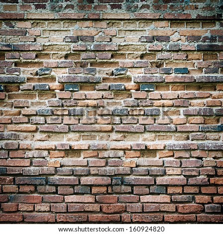 vintage grungy red and b black brick wall as background - stock photo
