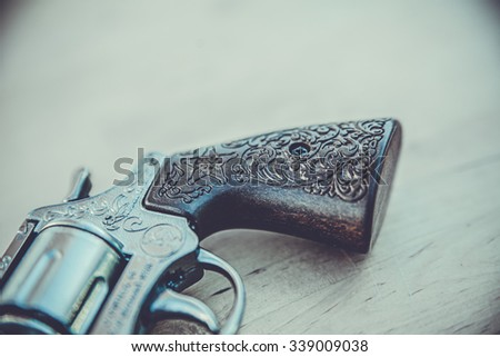 vintage gun on the table - stock photo