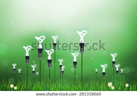 vintage hanging energy efficient twist light bulbs turning to flower concepts on blur background - stock photo