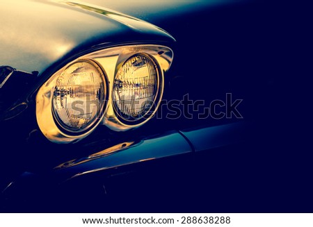Vintage headlamp of the old vehicle. Double headlights of retro car with chrome part on a black background for your design elements.  - stock photo