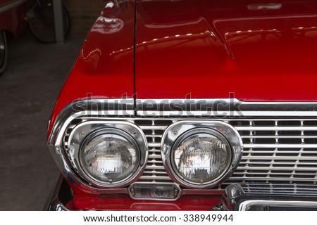 Vintage headlight US classic car - stock photo