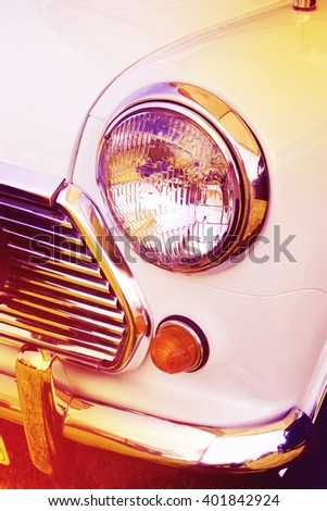 vintage headlight white car, retro style - stock photo