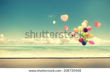 Vintage heart balloon on beach blue sky concept of love in summer and wedding honeymoon - stock photo