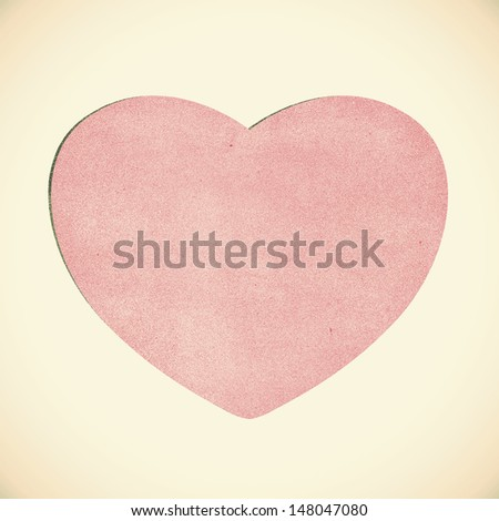 Vintage heart recycled paper on white background - stock photo