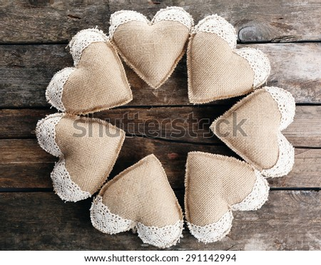 Vintage hearts on wooden background - stock photo