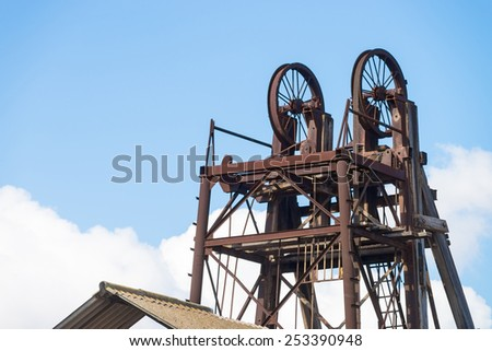 Vintage heavy industry equipment  in an abandoned mine - stock photo