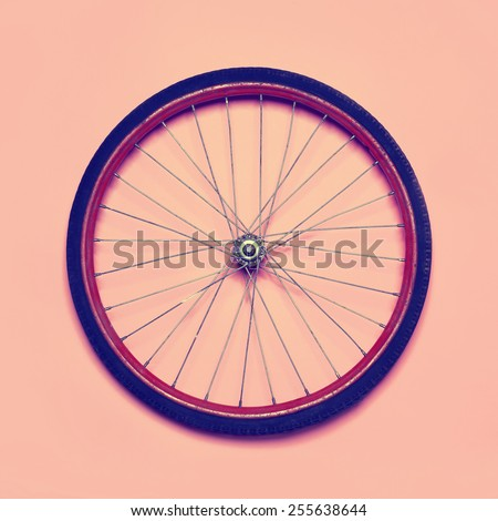 Vintage hipster photo bicycle wheel, abstract minimalism concept - stock photo