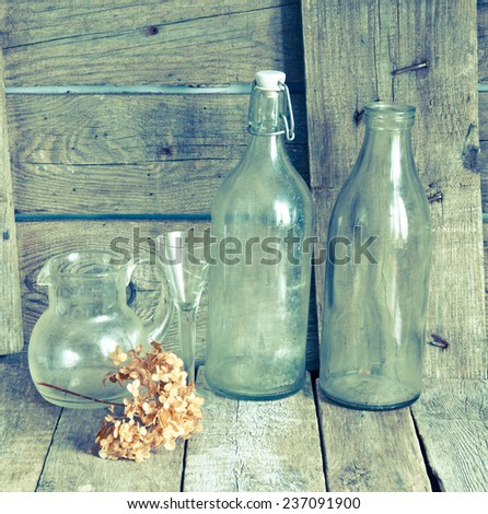 Vintage home decor with empty bottles - stock photo