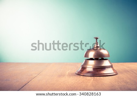Vintage hotel reception service desk bell. Old retro style filtered photo