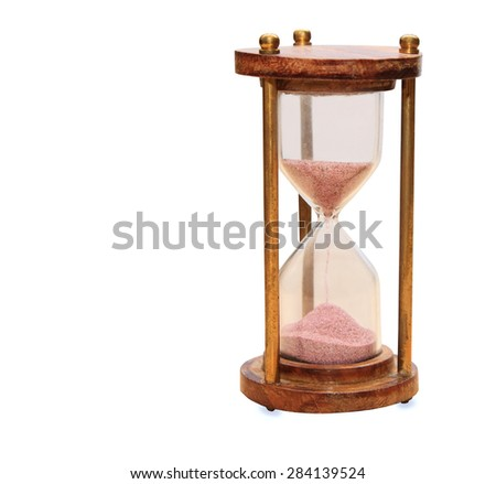 Vintage hourglass isolated over white - stock photo