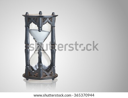 Vintage hourglass on gray background - stock photo
