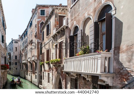 Vintage house with a balcony decorated - stock photo