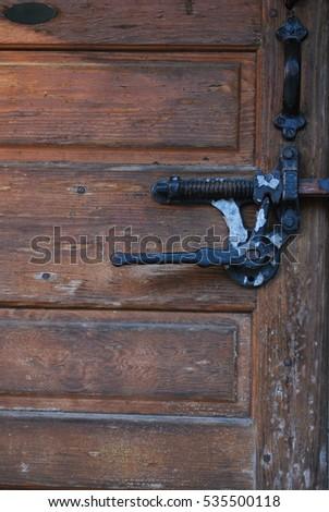 Vintage Ice company door lock and handle & Padlock Latched On Door Seen Through Stock Photo 702984175 ...