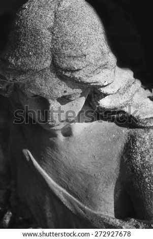 Vintage image of a sad angel on a cemetery (details) - stock photo
