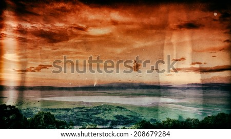 Vintage image of an African sunset over the Ngorongoro Crater, Tanzania - stock photo