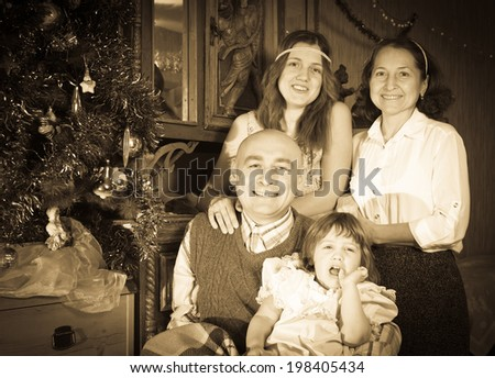 Vintage image  of happy  family celebrating Christmas at home - stock photo
