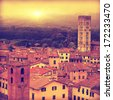 Vintage image of Lucca at sunset, old town in Tuscany. - stock photo