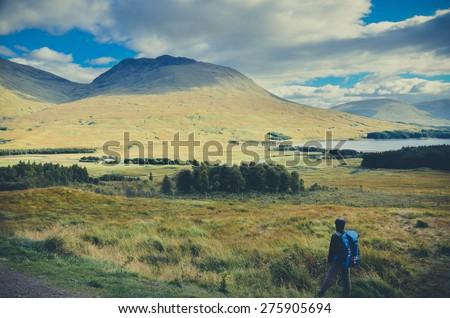 Vintage image of Traveler at Highlands in spring, Scotland, UK - stock photo