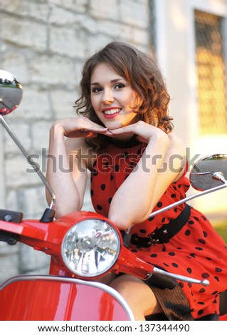 Vintage image of young attractive girl and old scooter - stock photo