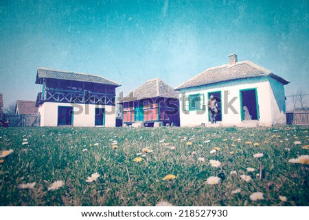Vintage image - rural landscape. Farm courtyard in spring - stock photo