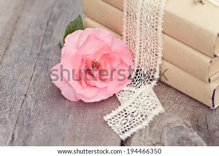 Vintage image with old books on wooden background - stock photo