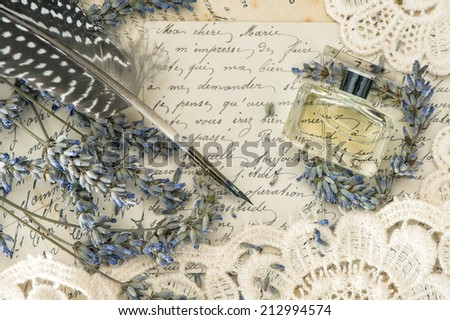 vintage ink pen, perfume, lavender flowers and old love letters. retro style toned picture. selective focus - stock photo
