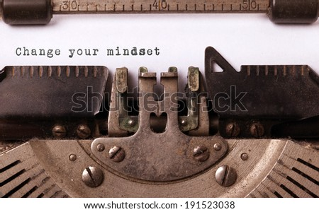 Vintage inscription made by old typewriter, change your mindset - stock photo