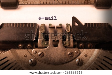 Vintage inscription made by old typewriter, e-mail - stock photo