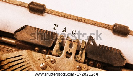 Vintage inscription made by old typewriter, FAQ - stock photo