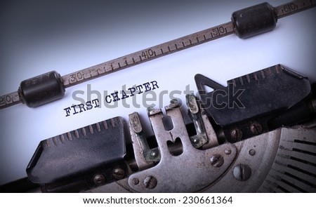 Vintage inscription made by old typewriter, First chapter - stock photo