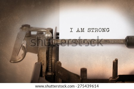 Vintage inscription made by old typewriter, i am strong - stock photo