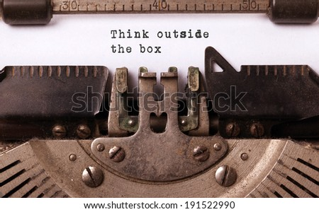 Vintage inscription made by old typewriter, think outside the box - stock photo
