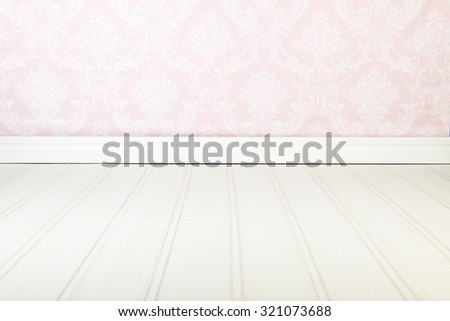Vintage interior with pink wallpaper - stock photo