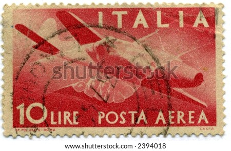 vintage italian postage stamp red planes 10 lire - stock photo