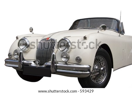 Vintage Jaguar - Convertible - a vision in white in front of a wall - stock photo