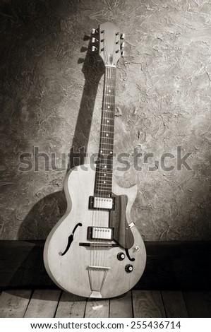 vintage jazz electric guitar in jazz club interior - stock photo