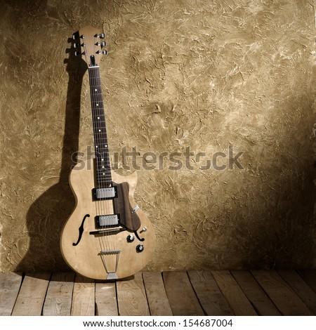 vintage jazz guitar in old jazz club - stock photo
