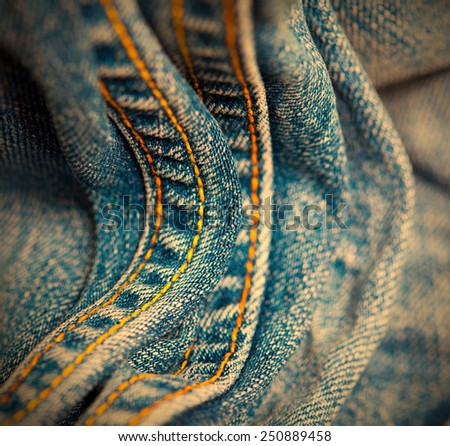 vintage Jeans with yellow stitching thread, close up. small depth sharpness. instagram image retro style - stock photo