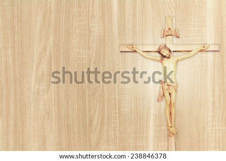 Vintage Jesus on cross put on wood background. - stock photo