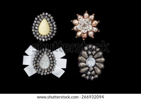 Vintage jewel buttons and Sewing accessory isolated on black background - stock photo