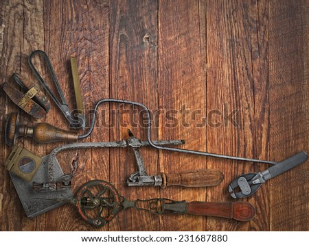 vintage jeweler tools  over wooden working bench, space for text - stock photo